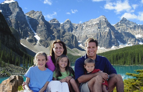 Happy family in front of mountains