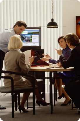 Group of employees looking at computer screen