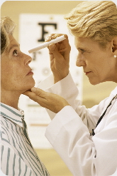 Doctor performing eye checkup on patient